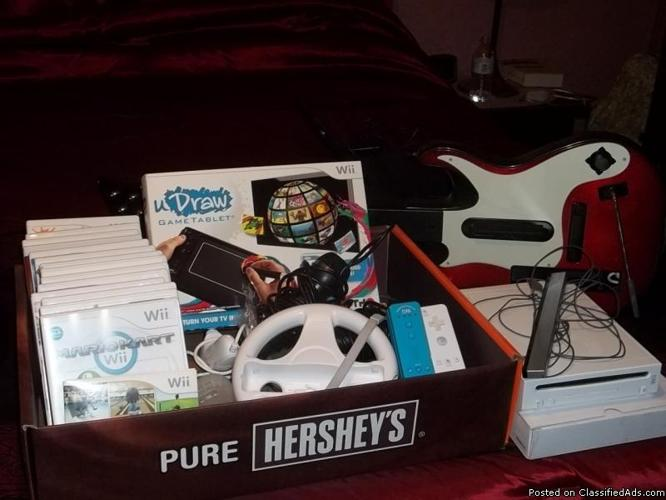 THE WII &15 GAMES &MORE - Price: 325.00