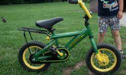 12 in John Deer bicycle. Like new. My son has only rode it about 4 or 5 times. Has a little rack on the back. I believe that I also have the training wheels for this. $75.00 firm. 812-498-3879