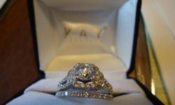 Engagement Ring: 14K white gold, Main Diamond is 3/4 carat round Diamond with 60 smaller Diamonds through out the band with 1 1/3 total carat weight, like new no defects. Wedding band: 14K white gold, Has 17 Small Diamonds around the band, totaling