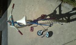 Girls bike, good condition; comes with training wheels that are detached.