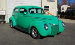 1939 Ford DeLuxe 2 Door Sedan All Steel Car with a 350 Chevy Engine, 350 automatic trans with lockup torque converter, frame off build 11 years ago, 16,000 miles since built, MustangII front end, rack and pinion steering by Chassis Engineering, Nova rear