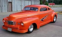1947 NASH STREET ROD...2 DR COUPE....CHOPPED..FRENCHED HEADLITES AND TAILITES....BUILT IN LOUSIVILLE KY....INTERIOR ORANGE AND TAN TWEED BY VERNON..CUSTOM CANDY TANGERINE BY PEVETO CUSTOMS...R.H.S 355 C.I. W/AUTO TRANS...POWER WINDOWS,.A.C....TILT..7500