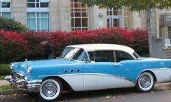 It is Two-Toned, baby blue and cream coloured with LOTS of chrome in good condition. The interior is tones of blue and the dash is all metal...no plastic in those days. The seats, ceiling, carpets, are all new and the trunk and engine are very clean. It