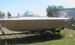 1958 creslin 15' comes with trailer, runs great call between 3 and 6 pm. --
