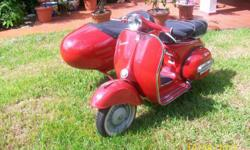 THIS IS A VESPA 1964 WITH SIDE CAR , RED , NO OIL NO GAS 4 SPEED 150 CC WE BRING THIS VEH FROM ITALY GOOD CONDITIONS PLEASE CONTACT ALBERT AT --