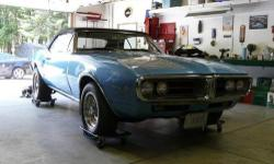 1967 Pontiac Firebird, very clean,runs great, convertible top almost new,seats almost new,everything works,professionally appraised in 08 @ 32-35 thou.,also have original Pontiac rims and tires. Engine is a 400 C.I American. 2 speed trans., Stored in a