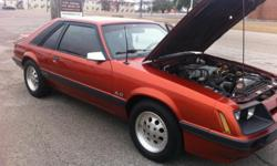 This is a 100% non modified 1986 Mustang GT 5.0 5-SP manual transmission . It is the first year that you can put antique tags on it. It runs great, drives great. The AC blows BURR cold. The heat gets HOTT. The car was originally red but was repainted