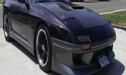 1987 Mazda RX-7 with 350 V8 engine and 700R4 Automatic Transmission and lots more.. Phone no. --