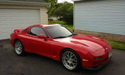 1993 Mazda RX7 Touring Model. This car has no major modifications. The Engine was rebuilt at 64k miles and at that time I decided to remove the first of two catalytic converters. There are two and upper off the engine and a lower below the passenger