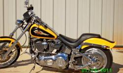 1995 Harley Davidson softail! yellow and black with brand new Harley Davidson leather seat..... In meant condition except it does have scratches down one side but nothing major.....not noticeable unless up close really so it still can be ridin without
