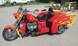 My eMail : jordandebraljj@1mum.com This 1999 Boss Hoss '57 Chevy trike couples the iconic fins of one of the most recongnizable cars ever produced with the thrill of a V-8 motorcycle. The trike features a factory 350ci V-8 GM engine making almost 400 HP,