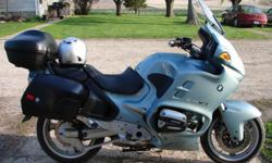 Light Blue in color. 19,000 miles. New Dunlap tires at 18,200. Power windshield, heated hand grips, hard locking saddle bags and back bag. Repair / maintenance manual included. 18,000 mile BMW service was done.