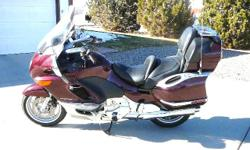 Burgandy LTC touring bike with matching side cases and top box. Includes AM/FM cassette and 6 Changer CD player. Factory intercom set up. Heated grips and heated seat. C Bailey electric windshield (+2 inch tall and 4 inches wider) ABS. Well maintained and