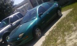 green color outside gray inside, cold air ,4door, 4 cylinder runs great,good tires auto trans/auto overdrive. { Cash ONLY } NO TRADING
