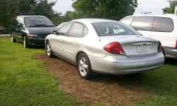 Buyers, this 2000 Ford Taurus SE  has around 151,600.on mileage, it is a 4 door , it's clean and ready to be sold. It has a 6 tract dvd changer in trunk. A new two year battery, Under warranty . The car has set for over 1 year and is being sold to
