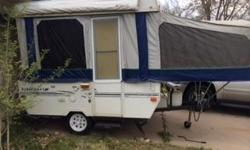 2000 STARCRAFT METEOR POP UP CAMPER 10 feet folded - 14 feet open 1 Queen Bed - 1 Slider bed Rap Around Couch that turns into bed. When needed 3 Storage Areas under Couch 2 Storage cabinets under Queen Bed 3 way Refrigerator Hidden Safe Forced AC/Heat 3