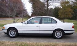 Alpine white with tan interior. Automatic Transmission. Full power, sunroof, leather interior, navigation system, & car phone. Rear window shades.