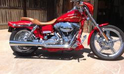 2001 Harley Davidson Dyna Wideglide 2 This bike is a CVO of Harley Davidson (custom vehicle operation) They only made around 1400 of this style RED with Gold flames and cafe fairing Ostrich leather seat Mileage:9,850 Tires have approx. 1,000 miles Very