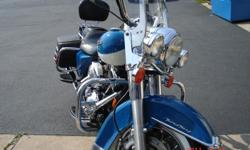 2001 road king teal & white bike has 43000 miles . at 32000miles i had a stage two 95 cc kit installed with 203 cams new cam bearings python silp on muffers and a power commander . harvs hd did all the work. last year had a new stator installed. done by
