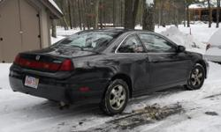 2001 honda accord coupe. black. 150k. Looks a little rough but runs well.