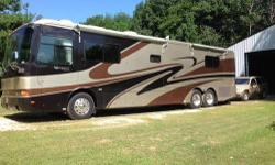 Cummins 370hp, Tag Axle, 2 Slides, Auto air levelers, 4 Door fridge w/icemaker, Ralph Lauren Interior, All Cherrywood, Corian countertops, Tile/wood laminate, Washer/Dryer, Queen sleep number bed, Lot of storage, Pull out basement drawers, Aqua Hot,