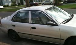 Silver, four door Corolla. Good condition, fully functioning, good body condition, 114,000 miles. New transmission and two new wheel bearings. Kelly blue book trade in value $4100 asking $3000.