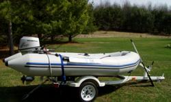 Zodiac Zoom 11ft 2in Open Pleasure. Fiberglass interior floor Comes with 2003 Haul Rite Trailer, 2000 Honda 9.9 Outboard 4 Stroke Eng,Paddles and storeable anchor. Used less than 10 hours. Has been stored in my pole barn out of the elements Close to new