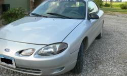 I have a 2002 ford zx2 with 70,000 miles. It is an automatic. It runs perfectly I've had the car for about 3 years and have never had any major repairs. This car is extremely reliable. the color is silver. It has new brakes and tires along with other