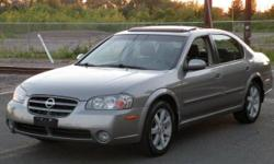 Automatic, Sedan, 6 Cyl, Gray. CD player, Passenger airbag, Driver airbag.