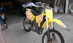 2002 Suzuki RM 125 2 stroke motorcycle. This bike is in very good condition. Current registration, green sticker. I purchased the bike from Malcolm Smith Motor Sports in 2008. Here's what it has: fmf turbine core 2, spark arrester muffler, excel wheels,
