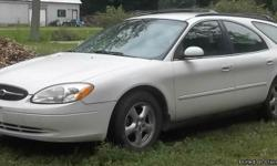 FOR SALE: 2003 Ford Taurus wagon; white; 6 cyl; 3.0 L; had only 3 owners, runs and drives good; has seat in the back so it seats up to 8 passengers; needs tires and some work done; 180,000 miles +; asking $2,500; call -- to come see it.