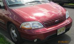 Burgundy color.mileage is 165.000 mile. seating campacitity is 8 people. it has tv in it. on the highway we get 20 miles per gallon we had oil change done every 3000 miles . Must sell moving to europe.