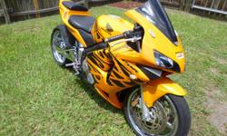 This listing is for a 2003 Honda CBR RR 600. It has 10,700 miles on it and has been lowered and stretched with a chrome swing arm and rims. Has an issue: won't start up when it is hot (possibly the starter). PLEASE SERIOUS INQUIRIES ONLY.*I will