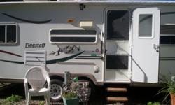 We have greatly reduced price to sell. Sellingfor health reasons.This trailer is in excellent shape. Lots of extra's added. Queenbed in front, bunk beds in back, central air and heat ducted through out trailer. Large fridge,