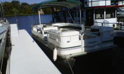 Nice family boat, easily seats 10 and has a nice, quite, economical Mercury 50 hp, 4 stroke motor(no mixing gas & oil) with trim and tilt. Large bimini top, built-in 20 gal fuel tank with guage on the dash, ancour, life jackets, mooring lines, curtesy and