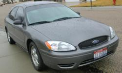 2005 Ford Taurus SE V6, gray exterior and interior, former corporate car, currently owned and driven (for the last 5 years) by an elderly woman who is retiring from driving. AT, AC, power windows and locks, power mirrors. 129,600 miles - 80%