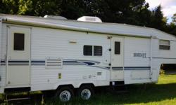 2005 Hornet 5th Wheel New tires,New extra awning, Super Slide, Heat and Air, microwave, stove with oven, fridge and freezer.Plenty of storage in and out, toilet with bath and shower,hot water heater,sleeper sofa,twin bunk beds with separate room and
