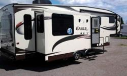 2005 Jayco Eagle HT RLTS Fifth-Wheel. This trailer is brand new, never used, still has wrapping on all parts, has been upgraded with loads of extra options. It has Air conditioning, furnace, HDTV, CD, DVD, remote control for Tip outs, remote for awning,