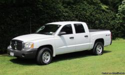 2006 Dodge Dakota Quad Cab with 4 wheel drive. Less than 10 miles on brand new tires (all 4), new battery, oil change and tonneau cover. 75k highway miles. Asking $10,750. neg. Call Davin @ ()-