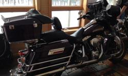 Clean, well maintained, stored indoors. 46,000 miles. Black Cherry. Extras added.