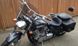 "Low mileage (11,500) motorcycle. Mustang seat for extra comfort on long rides, quick release windshield, leather saddlebags for weekend trips plus 2"" risers bring handle bars up and towards rider for greater comfort. New owner will also get original"