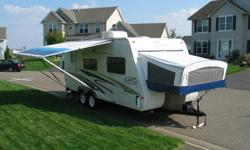 2006 Trail-Cruiser by Trail Lite. This is a hard top camper with fold-out canopy beds (one queen and one double). Sleeps six comfortably. Amenities include, awning, heat and A/C, refrigerator/freezer (works great!), microwave, propane cooktop with oven,