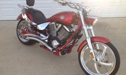"""Here are some features: 100 Cubic Inch Engine - 1634cc Fly Bar Handlebars Flame Grip Handles Arlen Ness Mirrors Removable 14"""" Custom made flame/chrome Luggage Rack Bike has (2) Ignition Keys Chrome Gas Cap with key entry that matches Ignition System Arlen"""