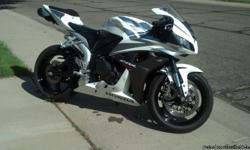 Selling my 2007 Honda CBR 600 RR. White/Black/Silver. Great Condition. 26k miles. Runs Strong. -Two Brothers Carbon Fiber Exhaust (Black Series) -Flush Mount Turn Signals -Frame Sliders -Blue Headlights -Bridgestone Hypersport tires -extras include