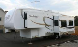 DON?T PASS UP THIS EXCELLENT 33 FOOT 2007 KEYSTONE CHALLENGER 29TRL FIFTH WHEEL TRAILER!!! NON-SMOKING, NO PETS LOTS of Features including: Ducted Roof Air Conditioning, THREE SLIDE OUTS, Sidewinder Hitch Pin Box, Skylight, Ceiling Fan and more! In the