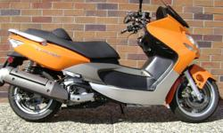2007 Kymco Xciting 500, 46 MPG!!!!- and offers quality and economy in a new bigger package. Its  500 dohc liquid-cooled engine delivers with highway speeds with plenty of passing power. KYMCO's popular cvt transmission provides stepless