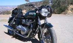 Excellent condition british green Bonneville. 9,500 miles. Some exterior modifications. D&D black pipes added as well. Have all original parts.