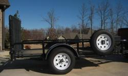 2008 10 ft. utility trailer. Full size spare tire, spring loanded rear gate & jack stand. This trailer is a one-owner and has been garage kept since purchased. Excellent condition.