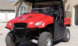 2009 Honda Big Red Side X Side. 127 Hours. 1500 Miles. Under warranty until July of 2013. Has a full Windshield, Half windshield, Back wind screen, Top and a Digital Dash. Great Shape.. Book is 7 to 9k without options.. Asking 7,900.00 --