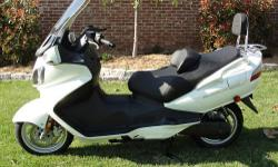 2009 Suzuki Burgman 650 scooter. It's in excellent condition with 1060 miles. It has a few upgrades like an aftermarket windshield, backrest, LED license plate frame and wig wag brake warning system. This scooter is in like new condition!